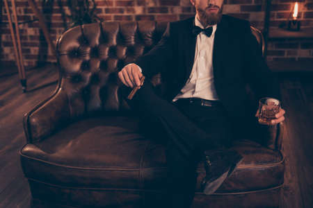 Meeting bar restaurant posh rich wealthy rest relax leisure lifestyle weekend look financier concept. Photo of serious virile masculine successful powerful elegant handsome economist sitting on divan Standard-Bild
