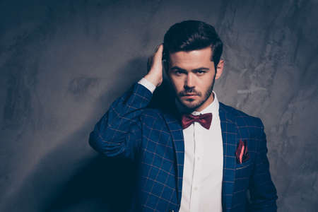 Charm confidence luxurious well-dressed apparel clothing person people concept. Close up studio photo portrait of handsome attractive man looking at camera touching hairdress isolated grey background Stock Photo