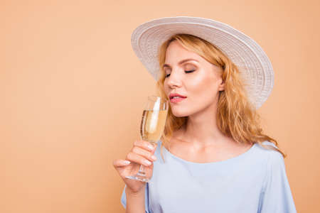 Close up photo portrait of beautiful pretty gentle tender sweet lovely lady tasting expensive drink holding in hand isolated on pastel bright color background