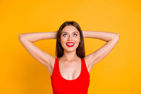 Enjoy your life! Close up photo portrait of beautiful cheerful lovely attractive with decollete cleavage lady keeping holding hands behind head planning imagine resort isolated bright vivid background