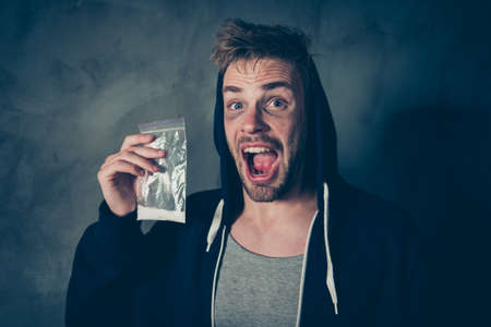 Untidy scaring frightening with mental problems guy holding plas Stock Photo