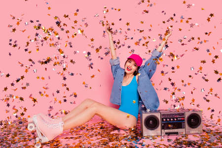 Disco dance dancer people person swimwear clothing concept. Beautiful funny funky rejoicing cool swag excited cheerful girl raising hands up sitting on floor isolated vivid pastel background