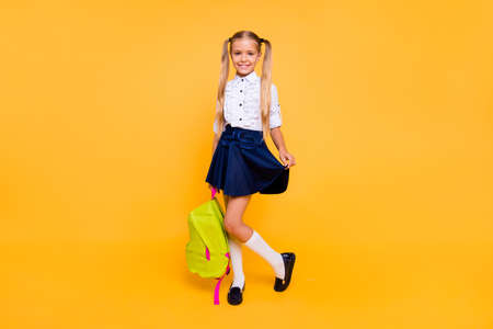 Full length, legs, body, size portrait of sweet, gorgeous, adorable, small blonde girl stand isolated on shine yellow background 版權商用圖片