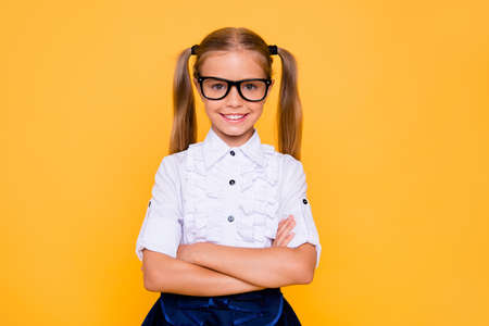 Im ready for new year at school! Close up studio photo portrait of pretty lovely adorable satisfied with toothy smile schoolchild wearing classic white trendy shirt isolated vivid background