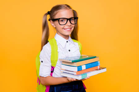 Back to school concept! Half turned close up photo portrait of lovely confident beautiful clever girl with copybook notebook wearing white blouse green bright backpack isolated vivid background