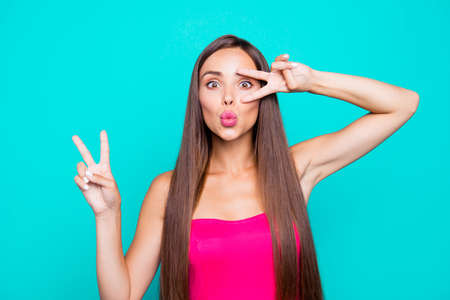Hey hi hello! Close up studio photo portrait of sweet lovely winsome fascinating lady giving v-sign staring looking at camera isolated on bright vivid pastel shinny background Banco de Imagens