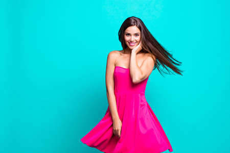 Young gorgeous nice cute attractive perfect smiling lovely glam girl wearing bright fuchsia mini short dress. Wind blows hair. Copy space. Isolated over bright vivid turquoise background