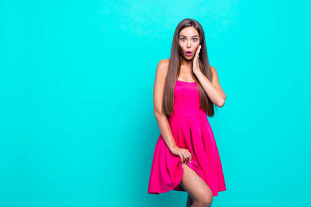 Close up photo portrait in studio of pretty cute sweet lovely charming glad nice with big pop eyes lady looking at camera holding dress with hand isolated on vivid blue background