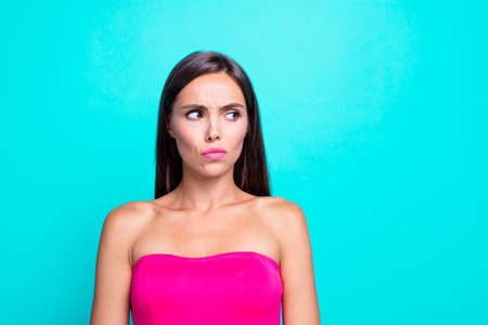 Close up studio photo portrait of suspicious strange offended upset sad lady looking on copy space planning smth isolated bright vivid background Stock Photo