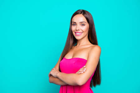Portrait of young gorgeous nice cute attractive perfect smiling girl with folded hands in fucsia dress. Isolated over bright vivid turquoise background