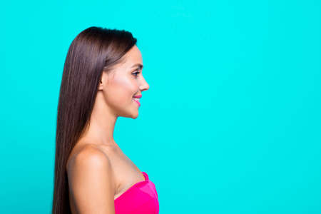 Half turned faced close up studio photo portrait of pretty lovely fascinating winsome nice glad satisfied woman with long straight brown hair isolated on bright vivid blue background copy space
