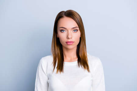 Portrait of pretty trendy woman in white sweater with concentrat