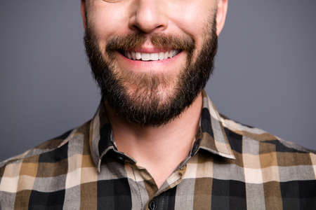 Close up half face photo of man beaming toothy smile isolated on