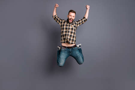 Young carefree, careless, man in a checkered shirt, jeans and sn Stok Fotoğraf