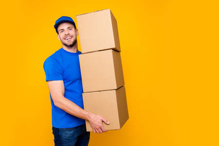 Portrait of handsome attractive funny bearded deliver in blue un