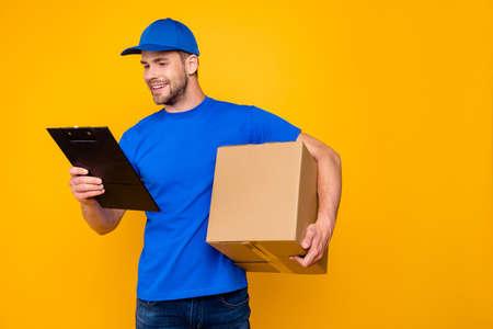 Portrait of handsome attractive cheerful bearded mailman, postma