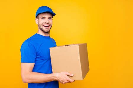 Portrait of handsome attractive cheerful mailman postman from po