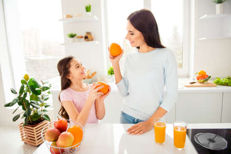 Beautiful lovely nice charming cheerful mom and her small little Stock Photo