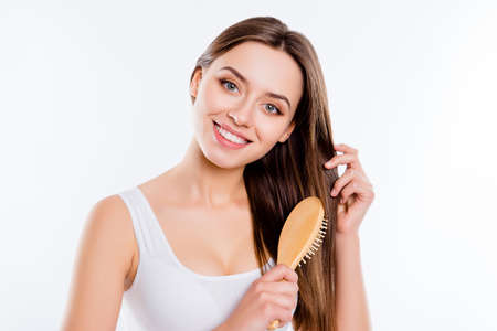 Portrait of adorable pretty woman grooming combing hair preparing