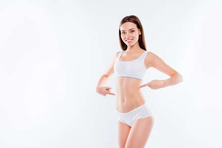 Portrait of joyful thin woman in white cotton underwear bikini