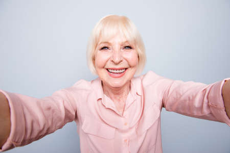Portrait of old adult blonde glad cheerful caucasian lady smilin