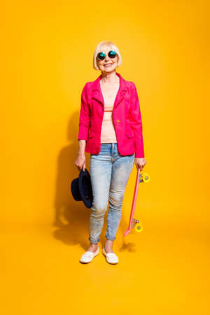 Full-body full-legh vertical portrait of modern elderly woman wi 免版税图像