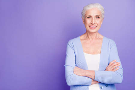 Portrait of confident elderly woman looking at camera with arms Фото со стока - 107763316