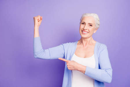 Strength concept. Beautiful nice cheerful smiling gray-haired ol Stock Photo