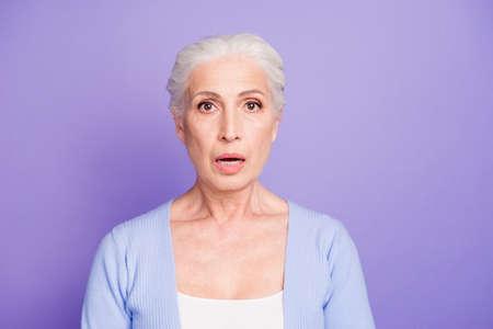 Portrait of grey haired old nice beautiful amazed shocked woman. Archivio Fotografico