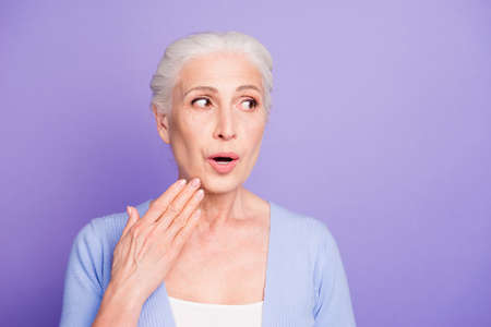 Portrait of grey haired old nice beautiful surprised woman showi Stock Photo