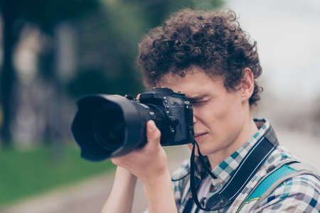 Portrait of curly haired cute attractive handsome guy blogger wi
