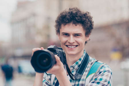 Portrait of curly haired cute attractive smiling handsome guy bl