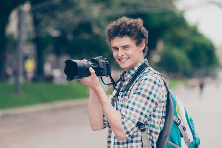 Curly haired cheerful cute attractive handsome smiling guy blogg