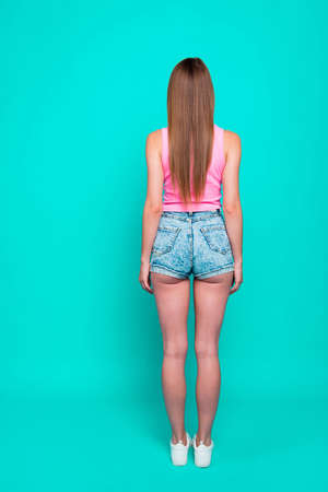 Rear back view, vertical full body size length image of girl, la