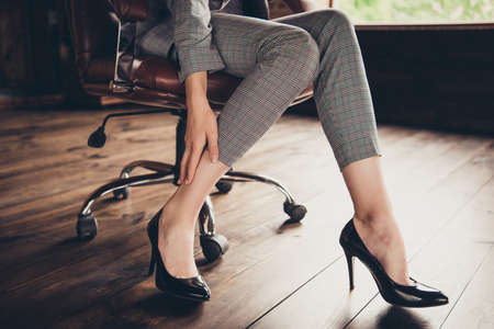 Close-up cropped classic stylish business ladys graceful legs i