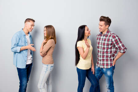 Four attractive nice young smiling friends, two girls and two gu Stock Photo
