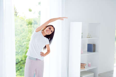 Daily home training fitness. Lovely charming beautiful nice styl Stock Photo