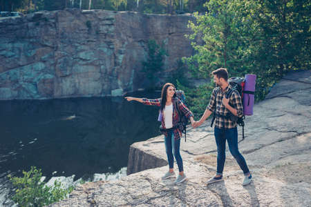 Two people on weekend hiking, wandering, exploring the world on Stock Photo - 107831366