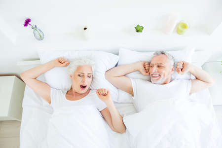 High angle top view photo of two aged grey hair people wake-up o Фото со стока
