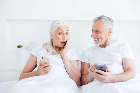 Astonishment reaction concept. Two funny gray hair people, perso Stock Photo