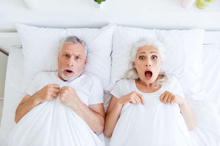High angle top view surprised couple gray hair people in pajama, Stock fotó