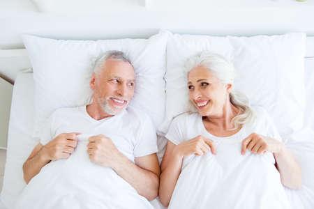 High angle top view of dreamy, couple in pajama, sleep, wear, sl