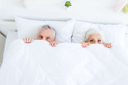 High angle top view surprised funny couple gray hair people in p