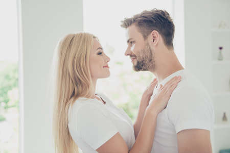 Side profile view of beautiful attractive sweet lovely couple Archivio Fotografico