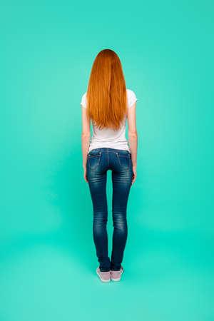 Full length, legs, body, size vertical back rear portrait of gir Stock Photo