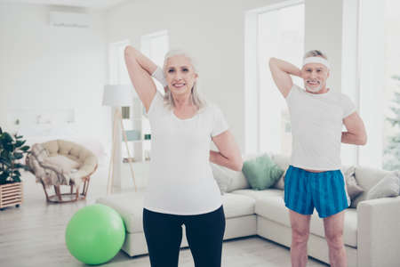 Two adorable healthy charming nice stylish trendy cheerful old m Stock Photo