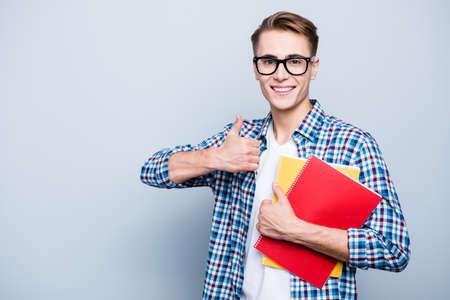 Portrait of careless, carefree teen, teenager highschool guy in Stock Photo