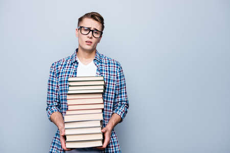 Portrait of tired, upset man in checkered shirt, eyeglasses, eye Stock Photo