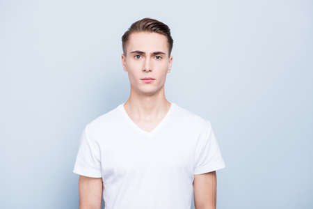 Portrait of nice, good-looking young man look at camera stand is Standard-Bild
