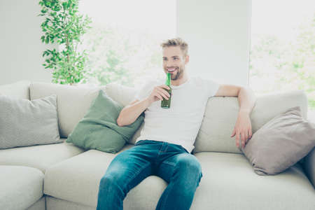 Careless, carefree concept. Portrait of handsome, bearded, nice, Stock Photo